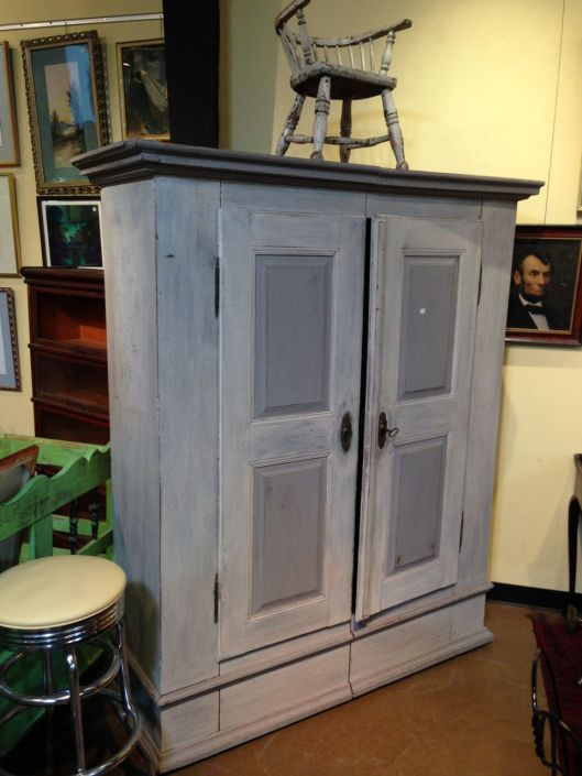 One big happy armoire. It might have been given the shabby chic treatment or been white from the factory. Click to revisit this blog.