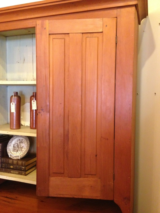A stepback cupboard with two vertical panels in the doors. Not rare but not common.