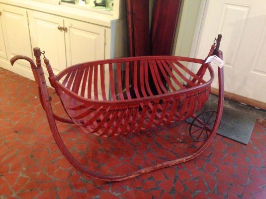 Wheeled bassinet with handles. Click to enlarge.