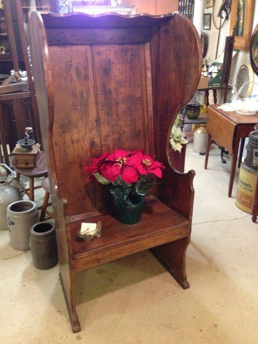 A nicely decorated settle. Poinsettias not included.