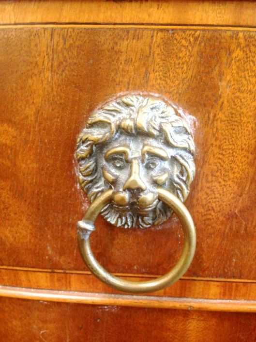 Lion's head ring pull. Not the only one in town. Click to see the  server from which it comes.