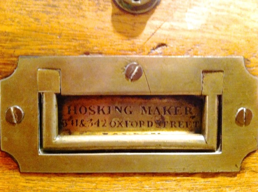 Campaign chest handle with maker's name stamped in the recess.