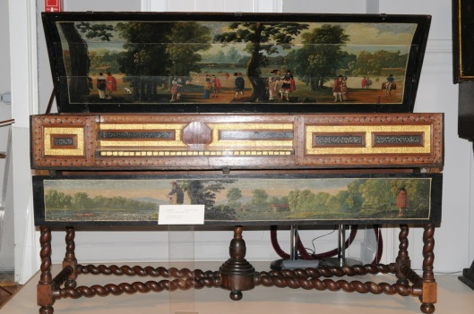 This is a virginal made by Adam Leversidge of London in 1666. A virginal is a harpsichord in which the strings are perpendicular to the keyboard.