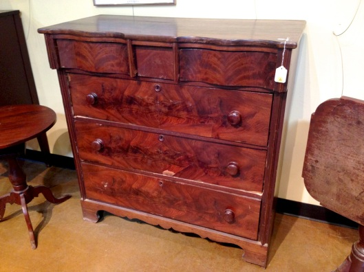 A dresser or chest of drawers.