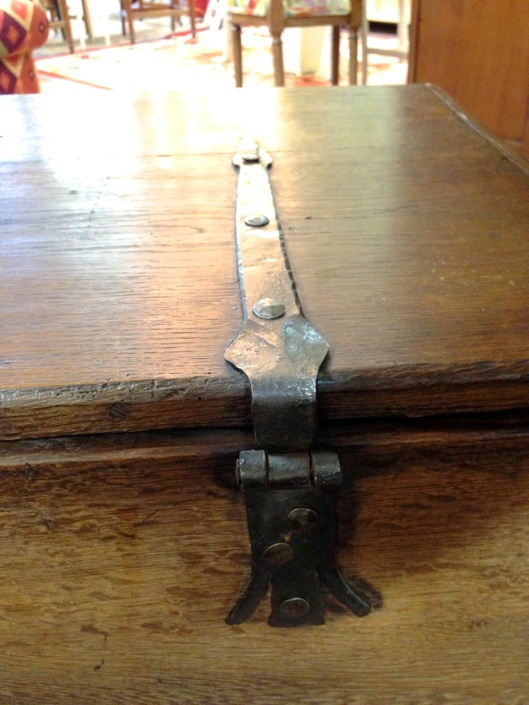 Hinge is attached with clenched nails.
