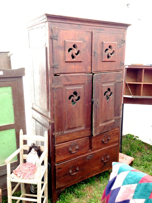 Interesting old cabinet. Hinges don't seem to come from a factory.