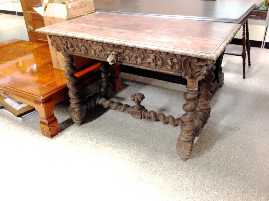 Carved table with barley twist legs and stretcher.