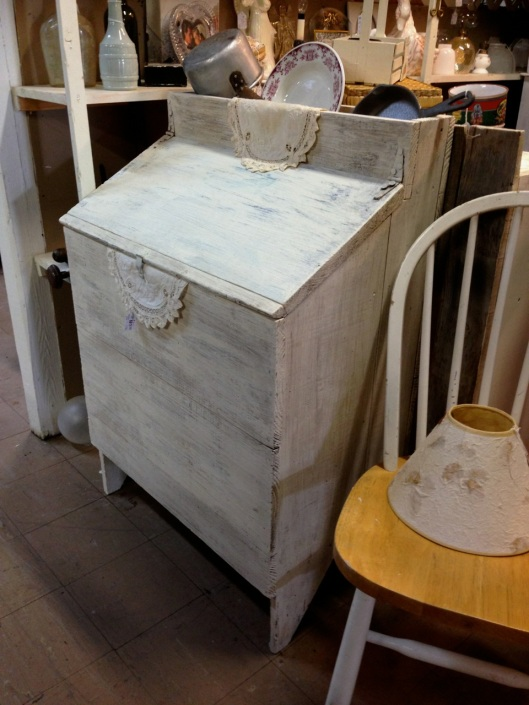 Boarded chest with storage on top.