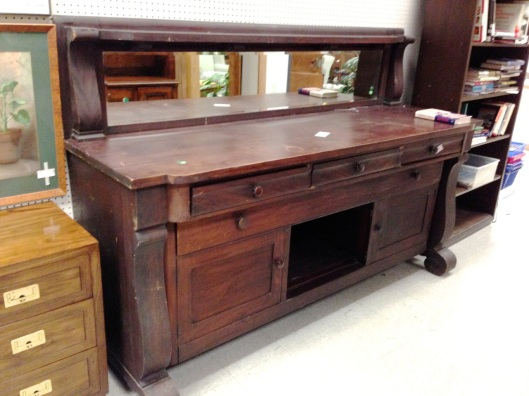 Note the width of the center drawer. Linen drawer?