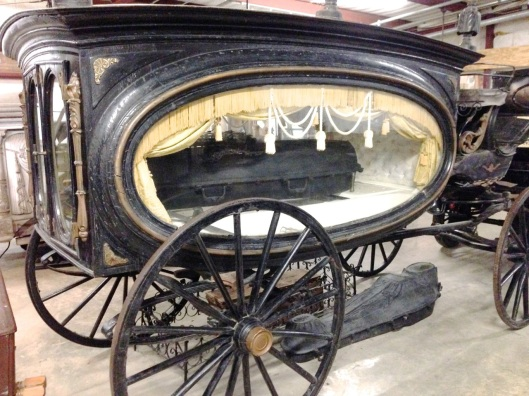 A hearse with a cast iron casket.