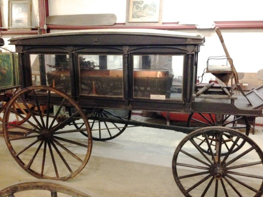 A hearse with a copper casket.