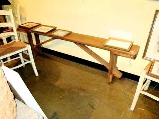 Another folding wooden bench.