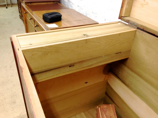 A chest with a till on the left.