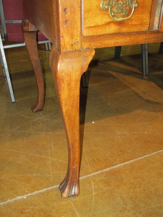 A muscular cabriole leg.