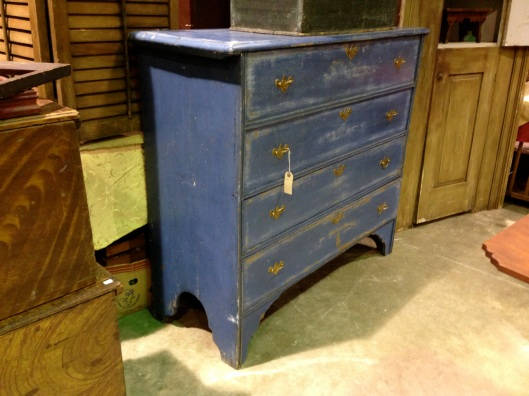 A boarded chest-of-drawers.