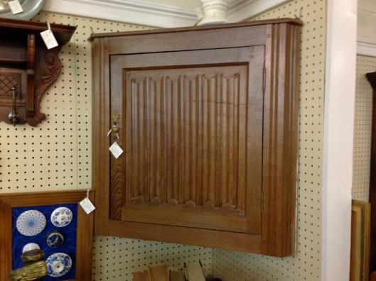 Carved corner cabinet.