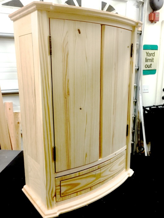 The curved front cabinet in SYP (southern yellow pine) and white wood. Constrction grade lumber.