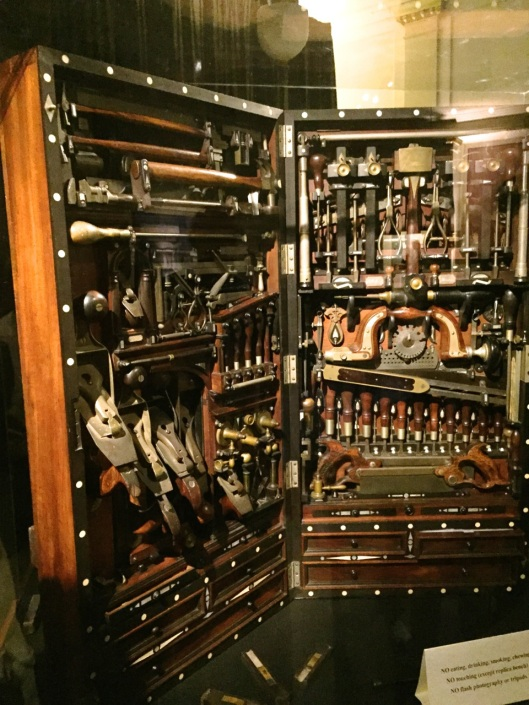 The Tool Chest in a darkened room with dramatic lighting.