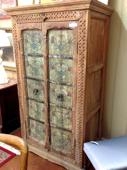 An armoire with painted panels.