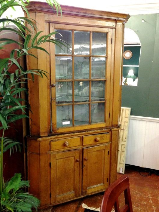 An attractive corner cabinet.