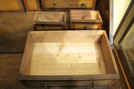 Top drawers in the back aren't as deep as other drawers.