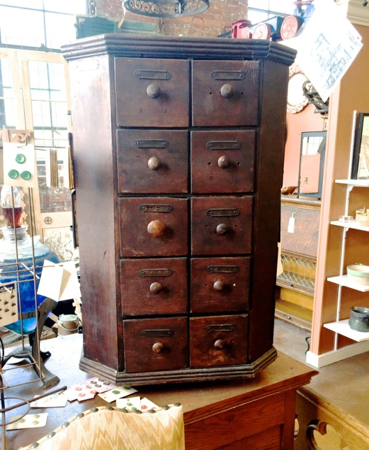 A forty drawer, revolving, octagonal cabinet.