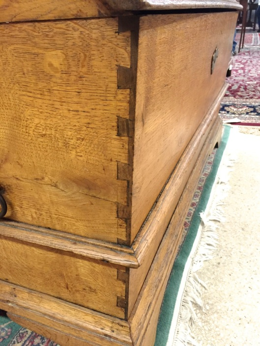 Broad half-blind dovetails on the ends.
