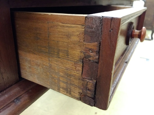 Dovetails are a bit rough but the applied moldings cover a multitude of sins.